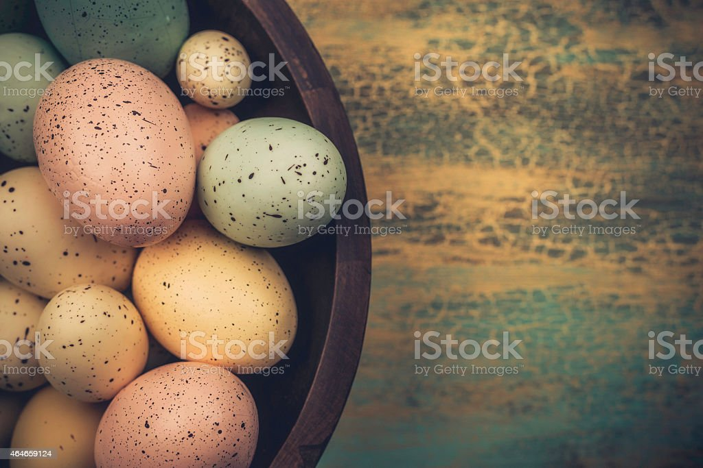 Rustic Easter eggs in wooden bowl with copy space stock photo