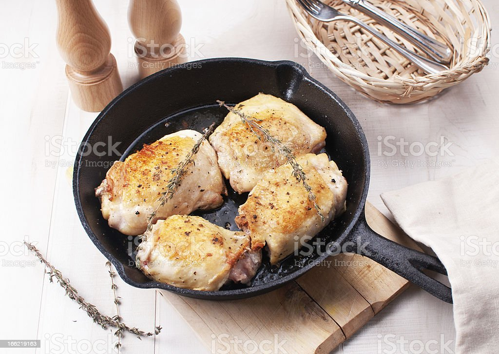 Rustic fried chicken thighs royalty-free stock photo