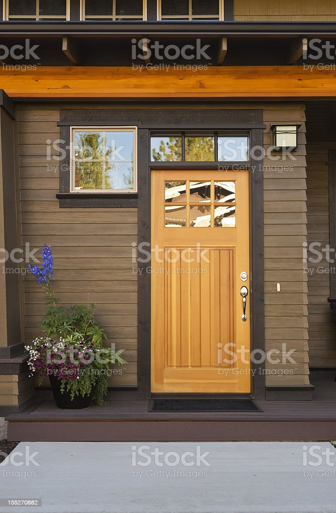 Rustic front door of an upscale home royalty-free stock photo