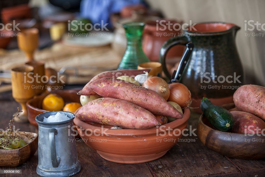 Rustic garden vegetables with old fashioned crockery stock photo