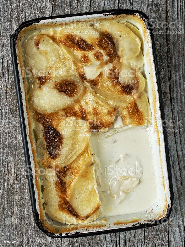 rustic golden scalloped potato gratin dauphinois stock photo