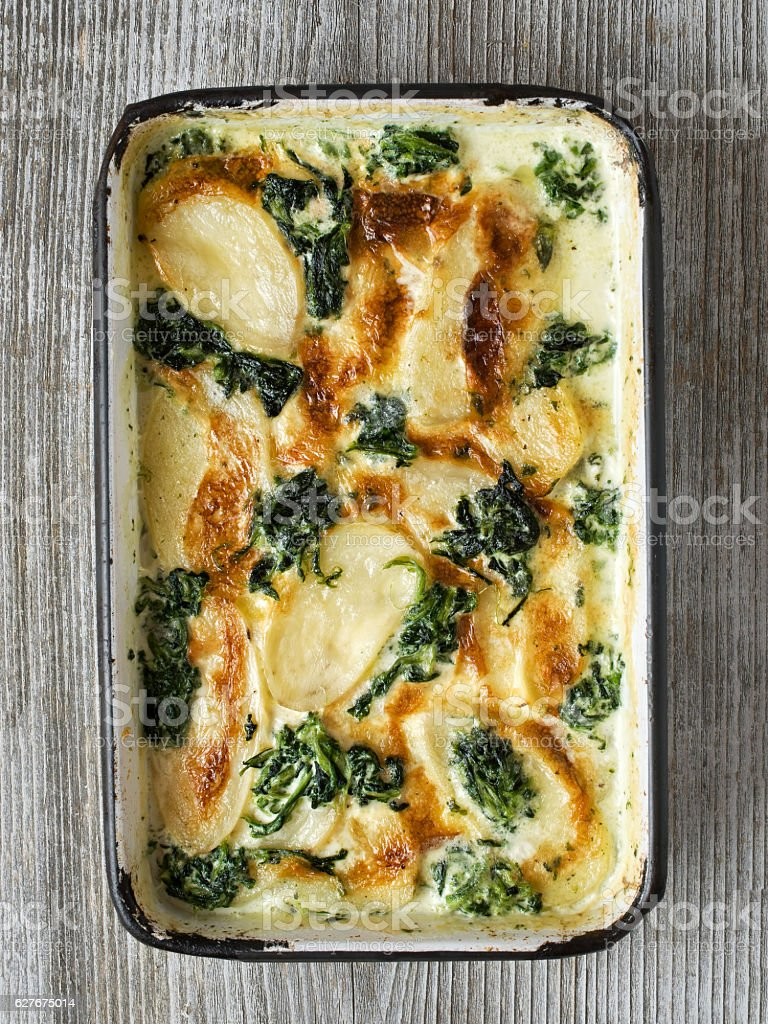 rustic golden spinach potato gratin dauphinois stock photo