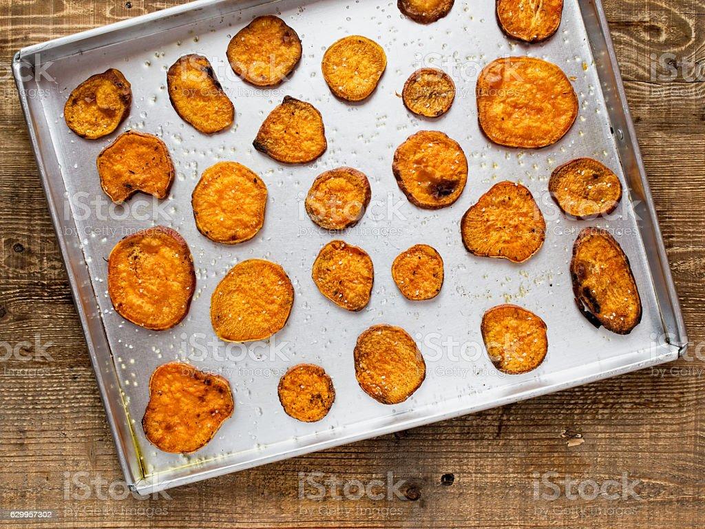 rustic golden sweet potato chips stock photo