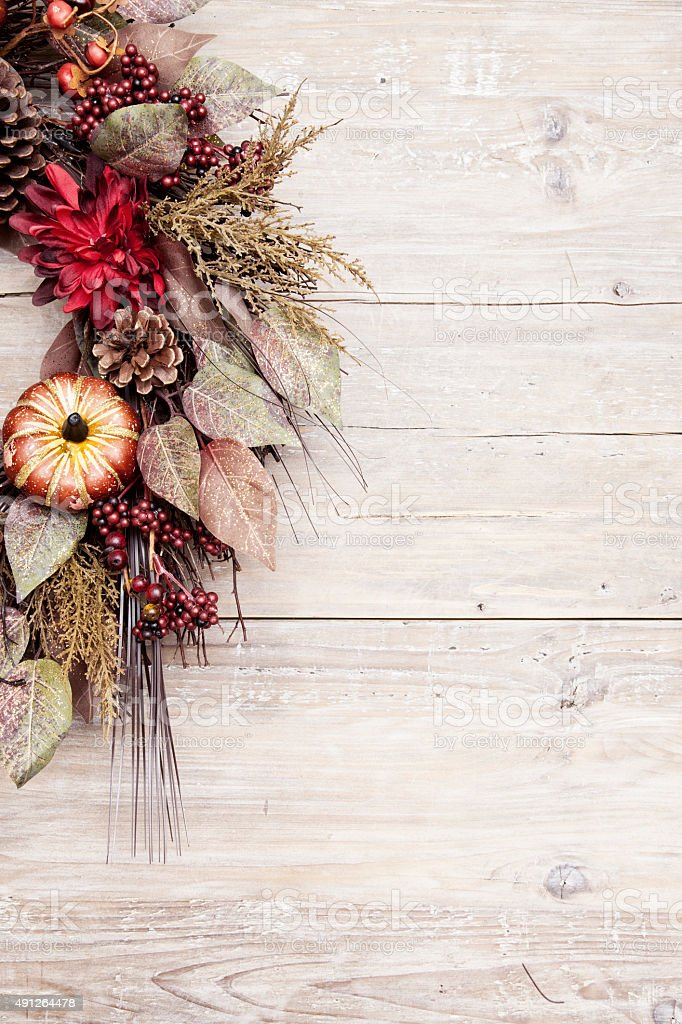 Rustic Holiday Wreath on an Old Wood Background stock photo