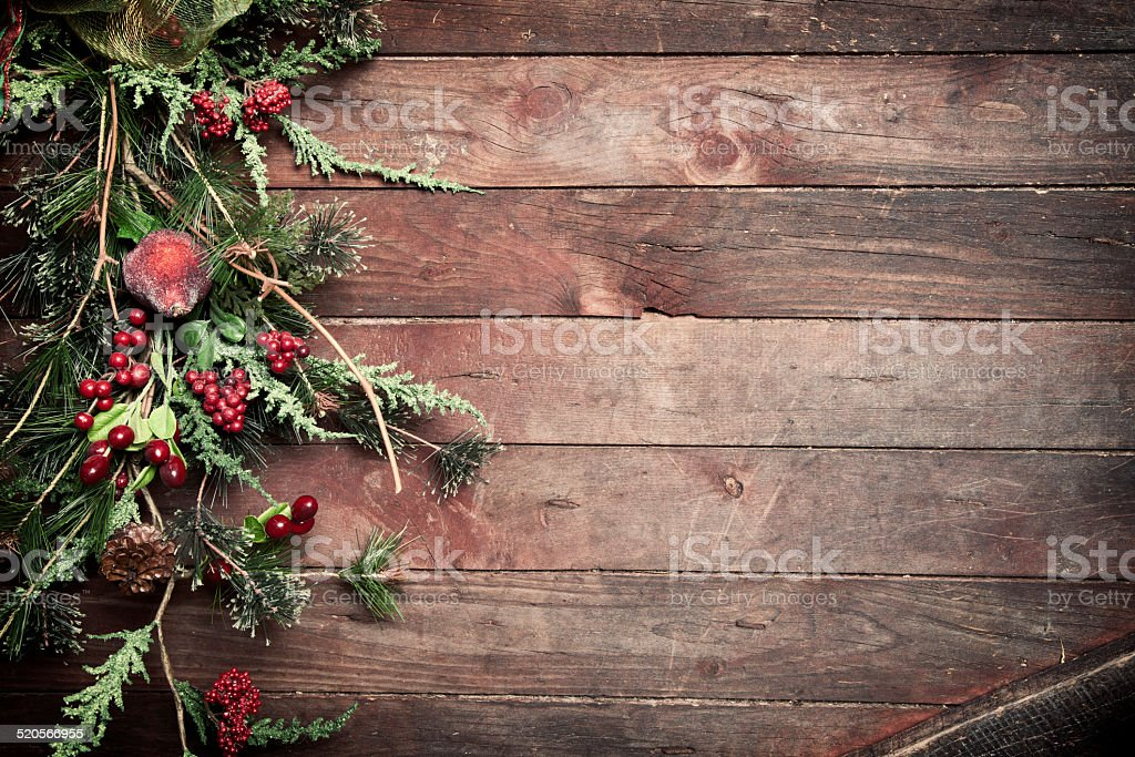 Rustic holiday wreath on old wood door stock photo