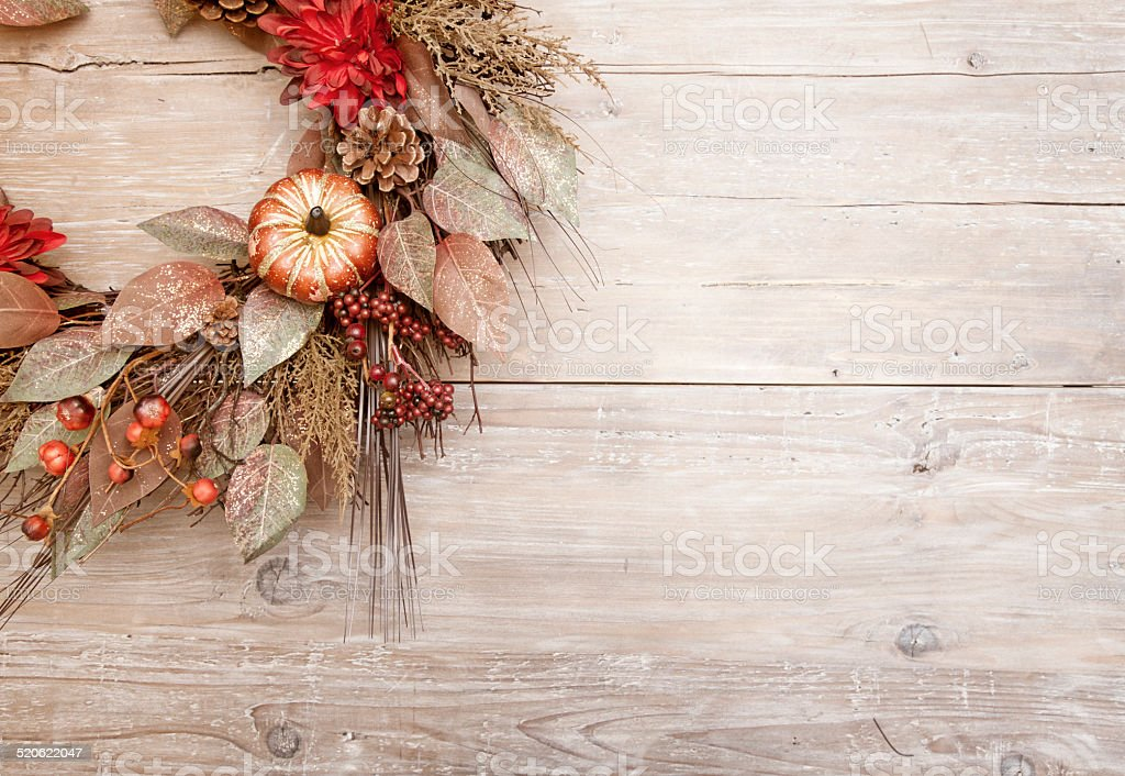 Rustic holiday wreath on old wood stock photo