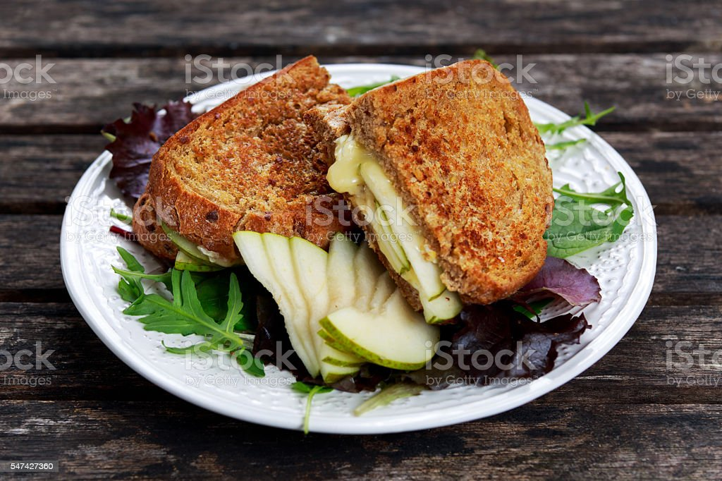Rustic homemade bread grilled into sandwich with Pear and cheese stock photo