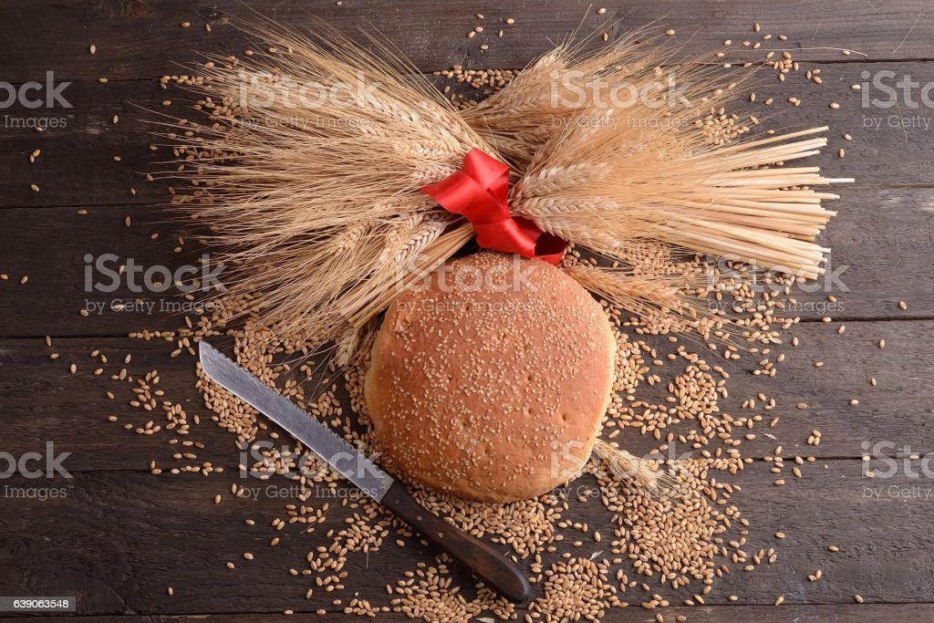 Rustic home-made bread with ears of corn stock photo