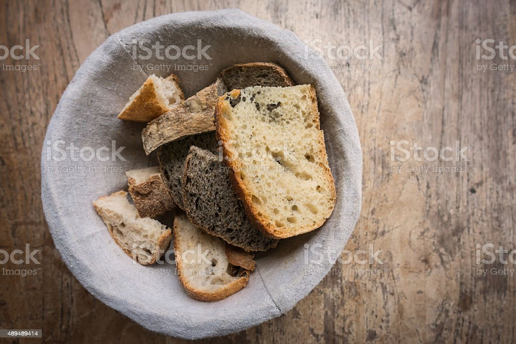 Rustic, Homemade Breads in a Bowl on Worn, Wood Table stock photo