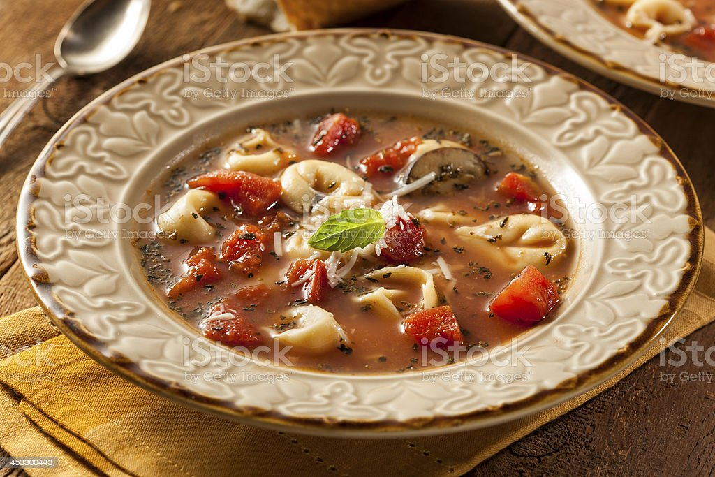 Rustic Homemade Tortellini Soup stock photo
