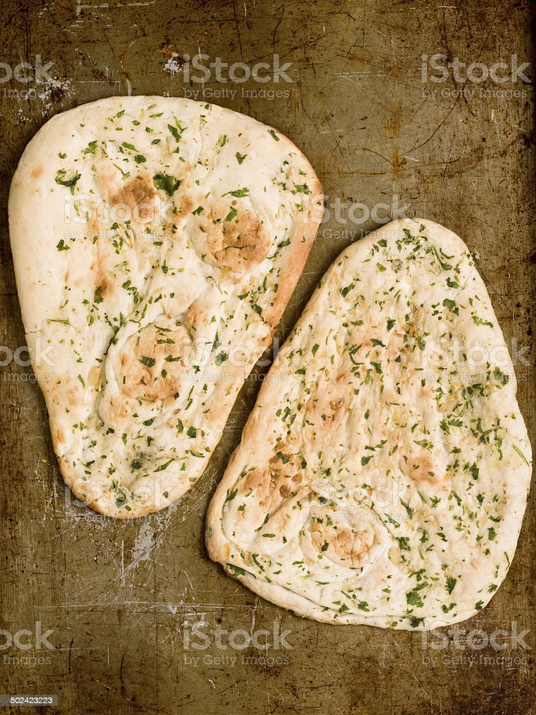 rustic indian garlic and parsley naan bread stock photo