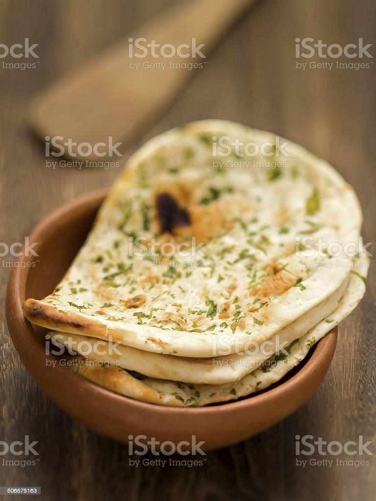 rustic indian naan bread stock photo