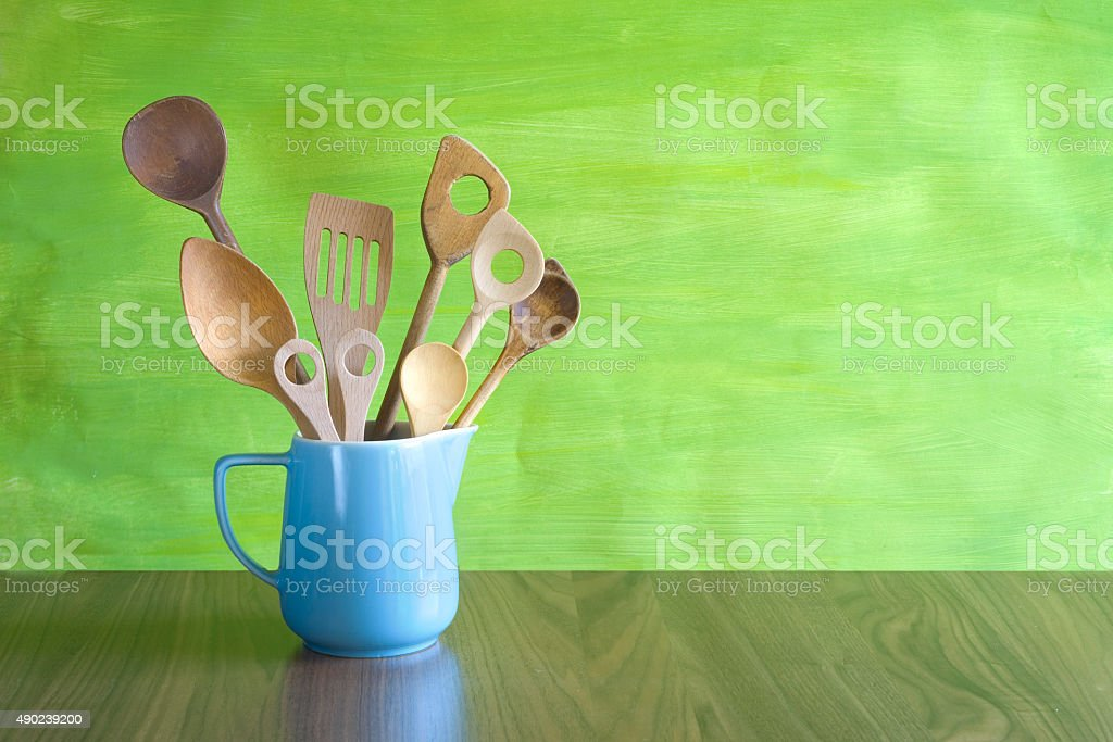 rustic kitchen utensils in an old jug stock photo