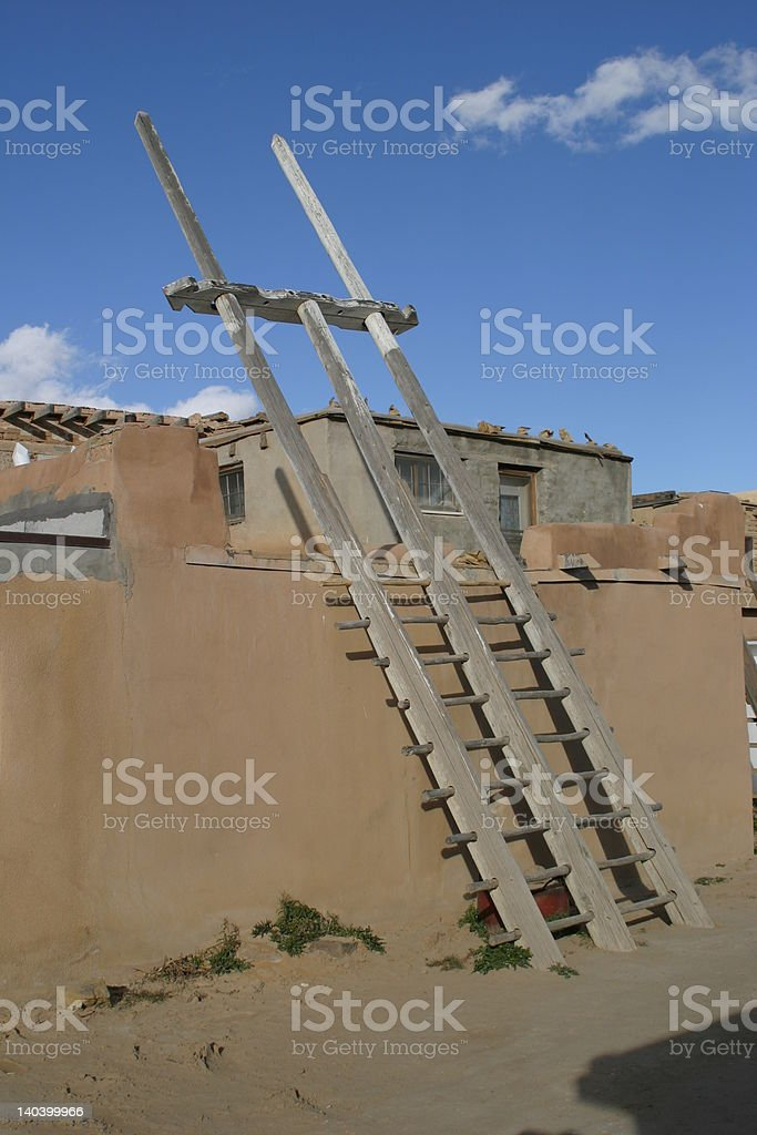 Rustic ladder to adobe house royalty-free stock photo