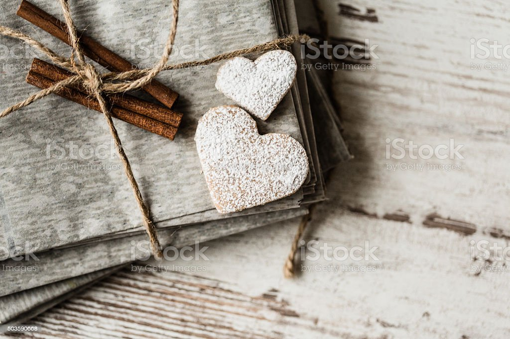 Rustic letters and heart shaped cookies stock photo