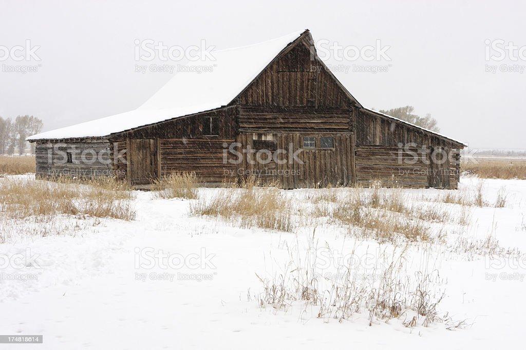 Rustic Log Barn Winter Storm royalty-free stock photo