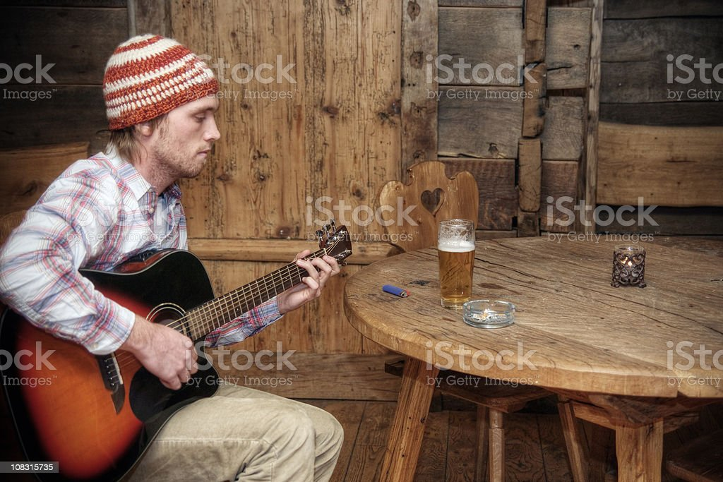 Rustic Musician with Beer and Cigarettes stock photo