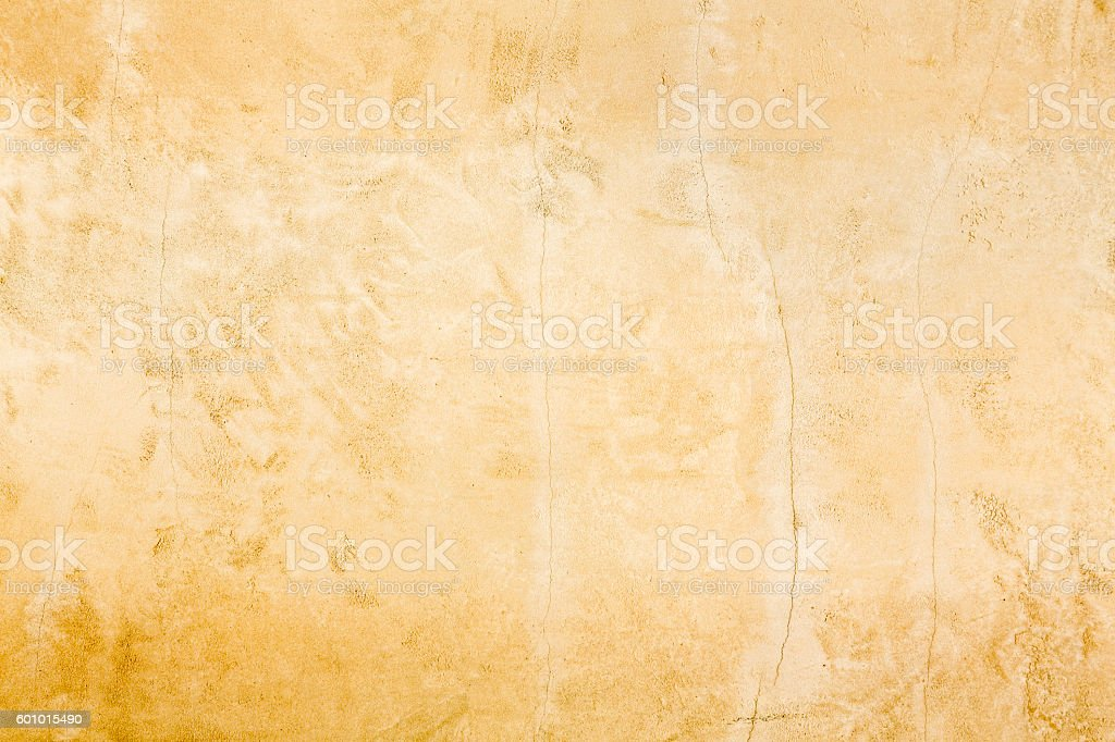 Rustic old aged gold stucco distressed horizontal background texture stock photo