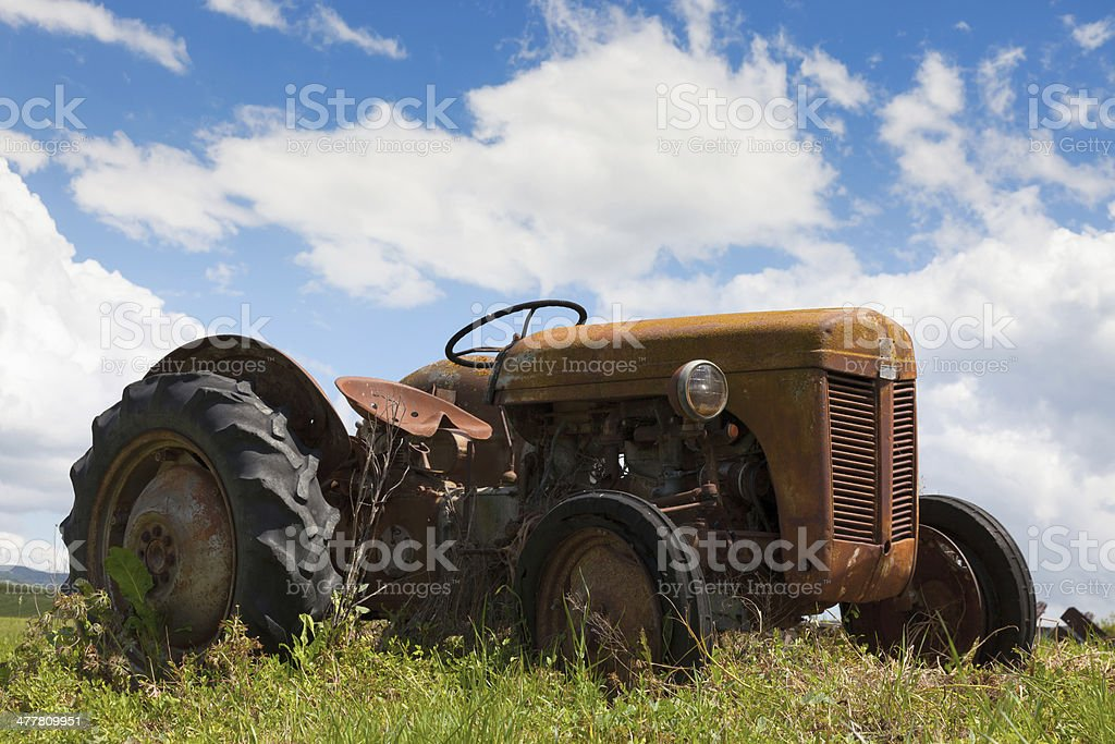 Rustic old tractor in Tuscany royalty-free stock photo