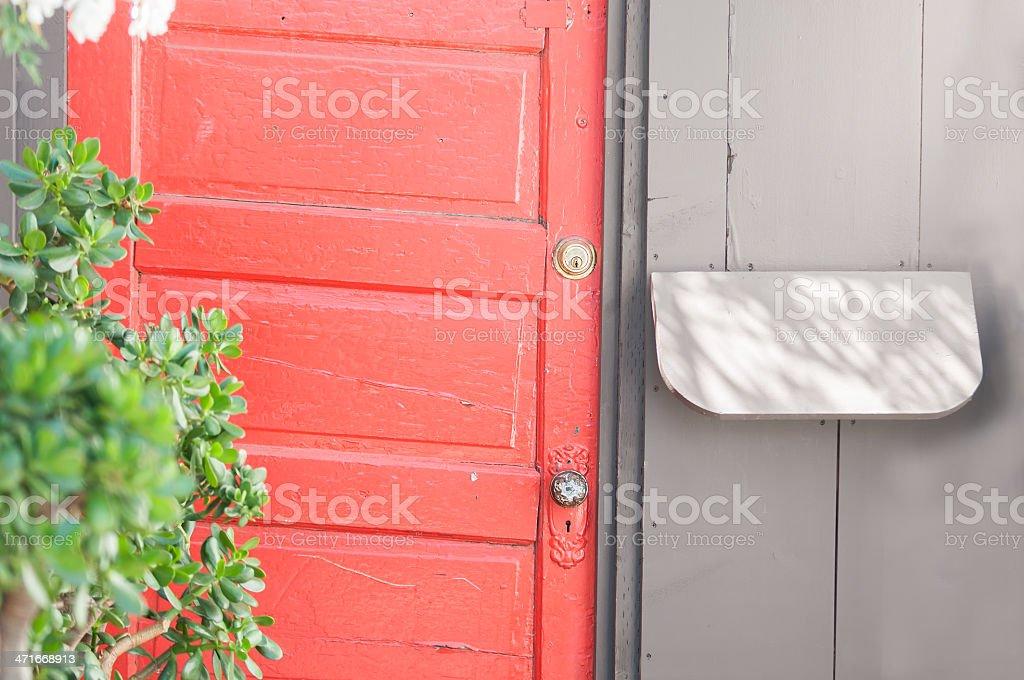 Rustic Orange Door and Mailbox royalty-free stock photo