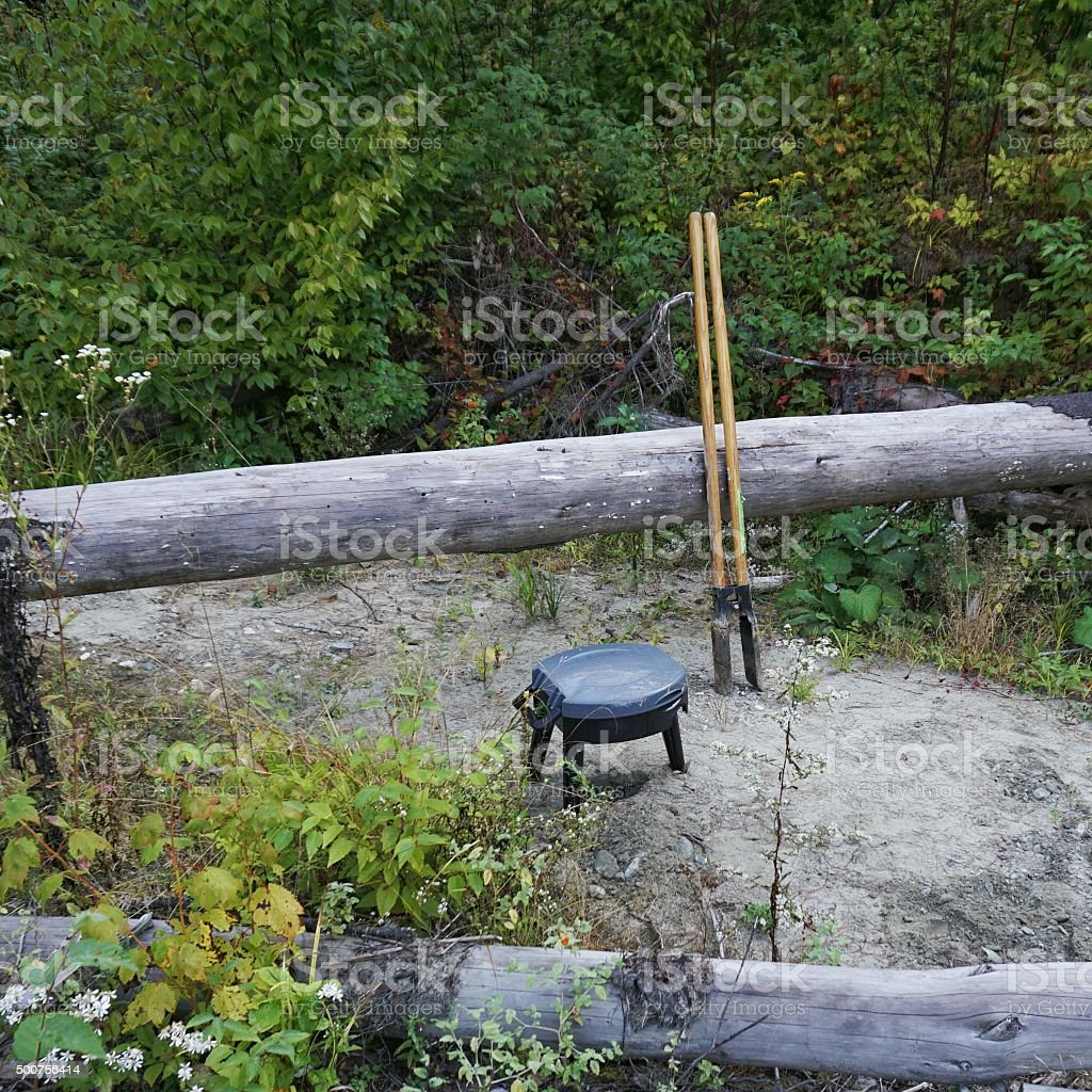 Rustic Outdoor Camping Portable Toilet Seat, Post Hole Digger, Bathroom stock photo