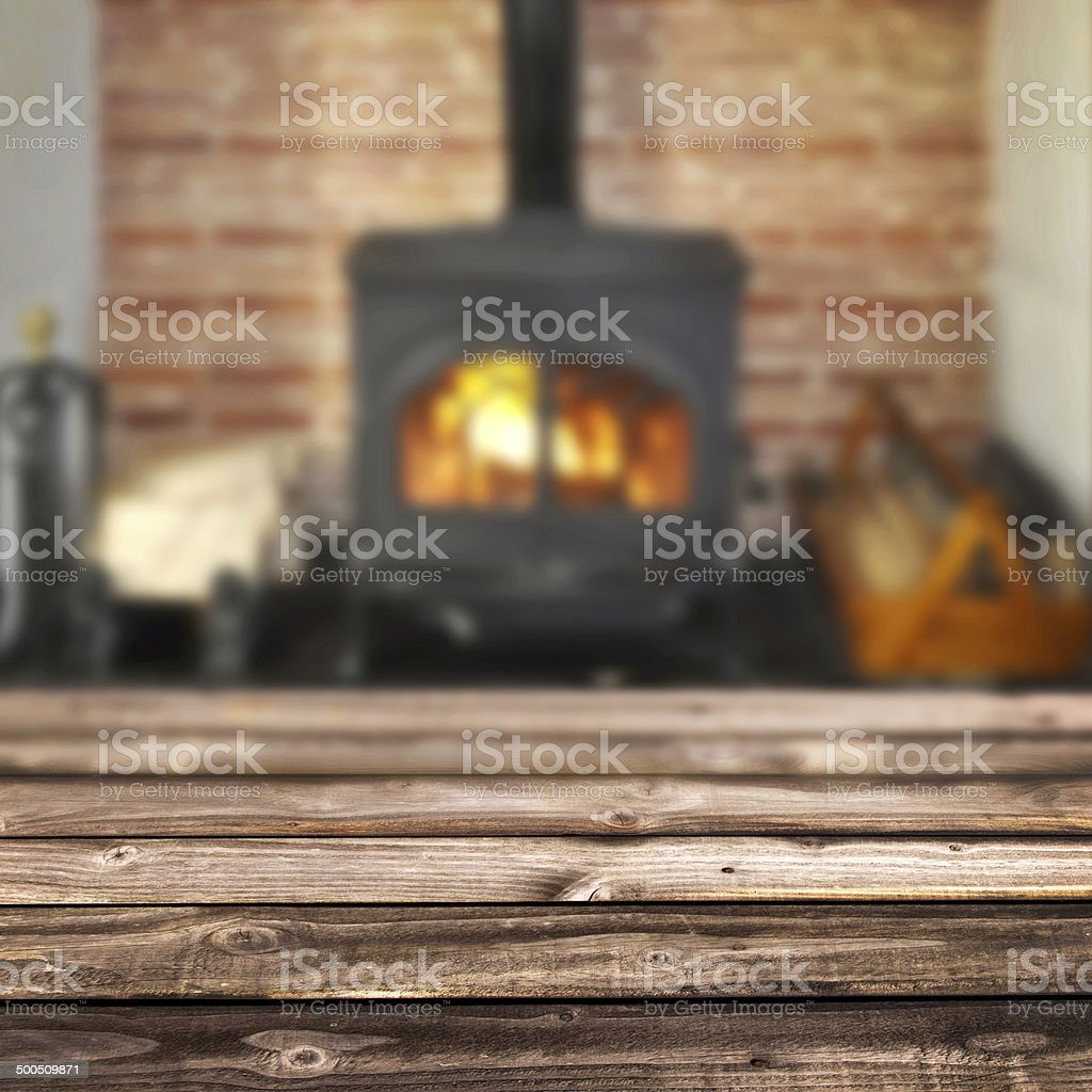 Rustic planks, wood burning stove in the background stock photo