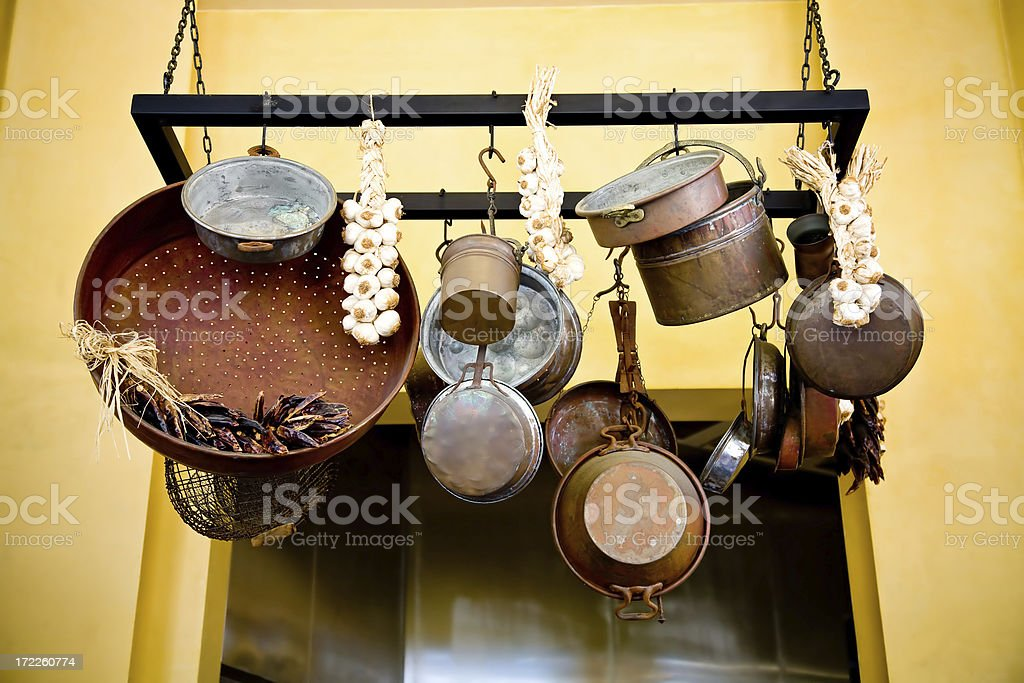 rustic pots and pans with garlic royalty-free stock photo