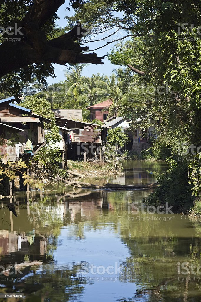 Rustic river housing in the tropics royalty-free stock photo