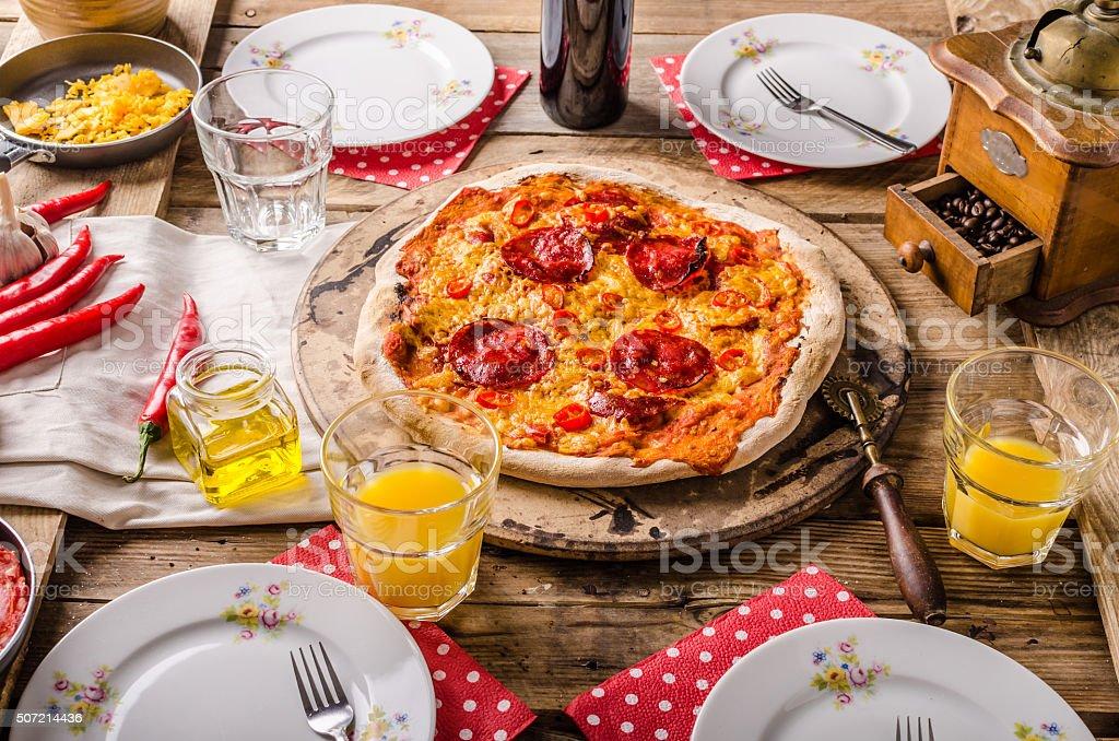 Rustic salami pizza with chorizo stock photo