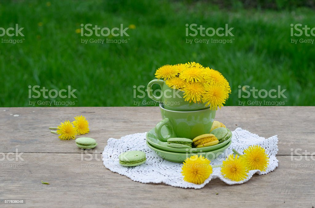 Rustic set of porcelain tea cups and homemade sweet macaroons stock photo