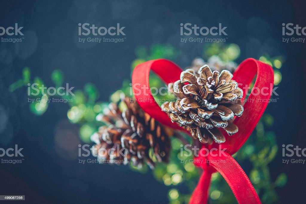 Rustic simple Christmas decoration of pinecones and ribbon in jar stock photo