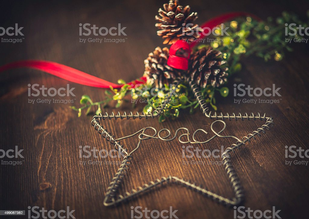 Rustic simple Christmas decoration of pinecones and ribbon on wood stock photo
