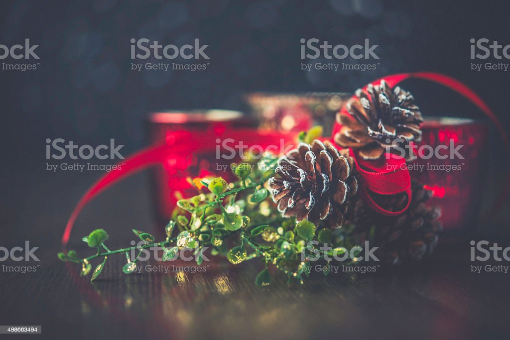 Rustic simple Christmas decoration of pinecones with ribbon and candles stock photo