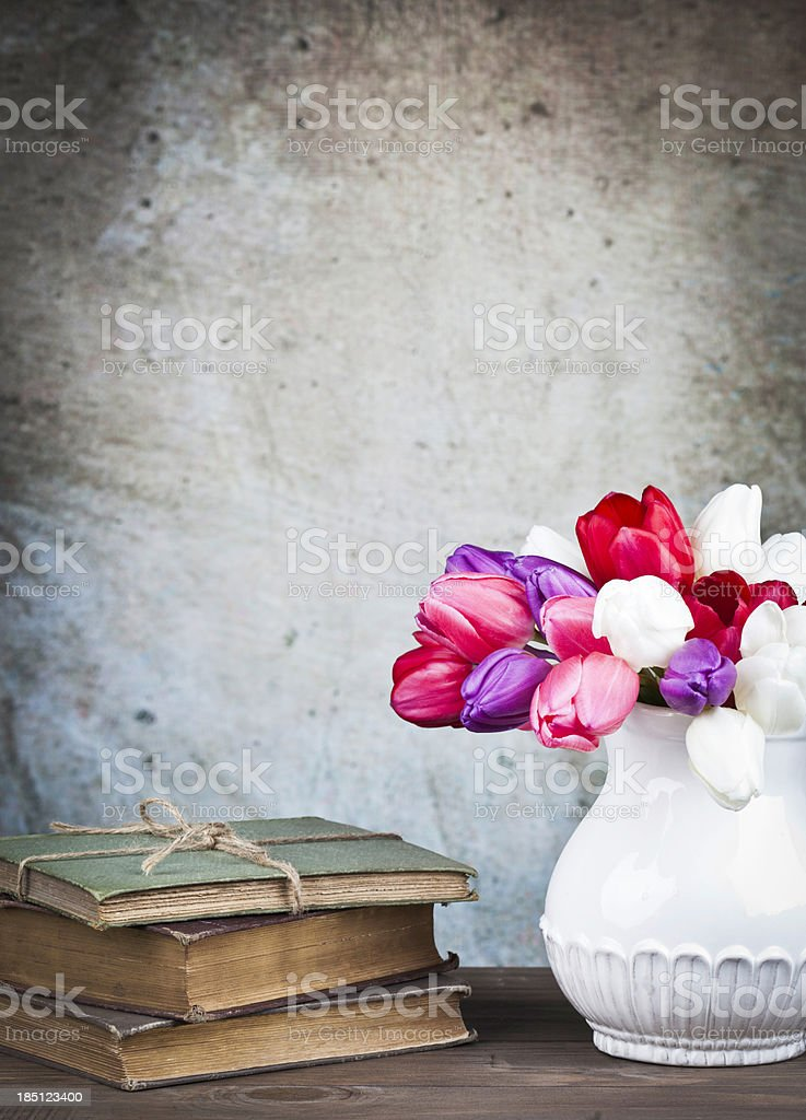 Rustic Still Life with Books and Tulips royalty-free stock photo