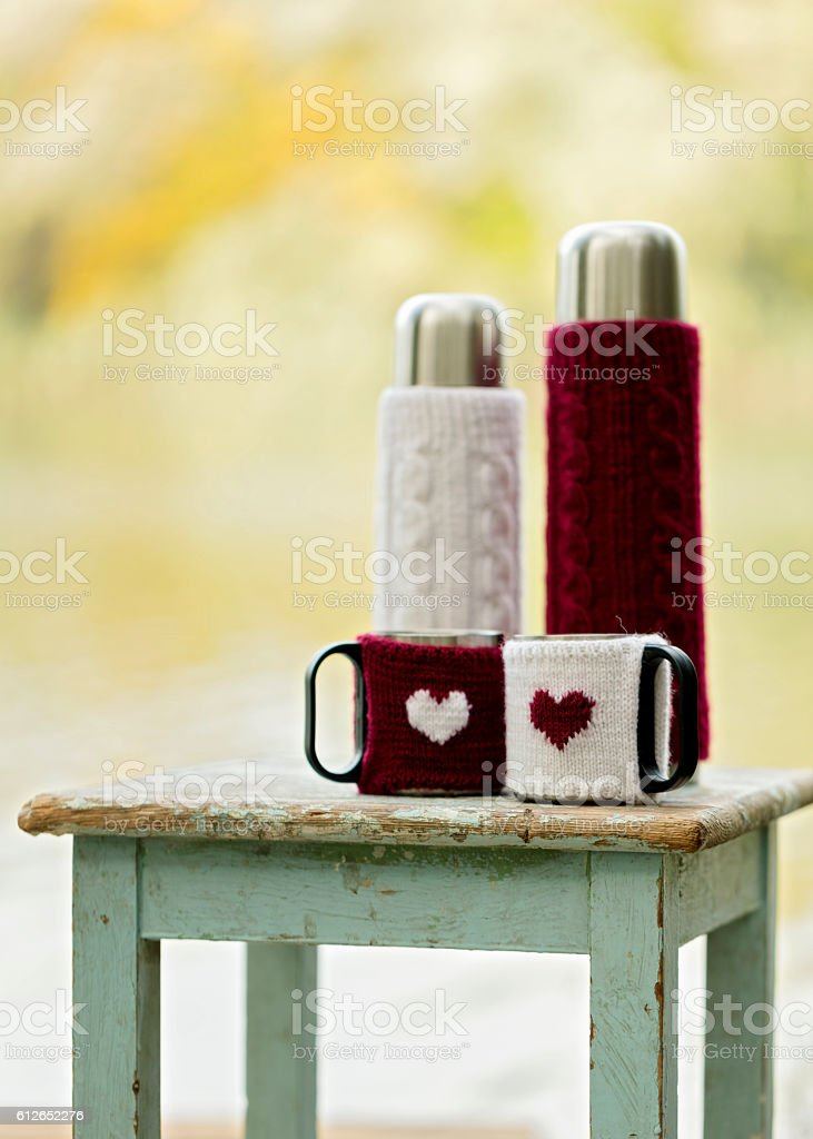 Rustic style. On the old stool is a thermos stock photo