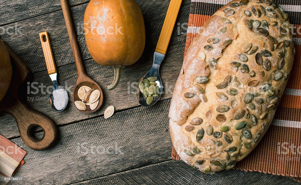 Rustic style pumpkins and bakery with seeds on cloth stock photo