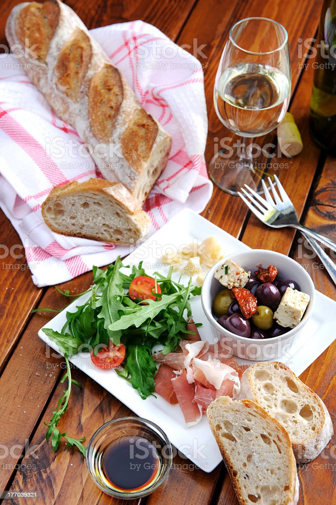 Rustic table setting with food stock photo