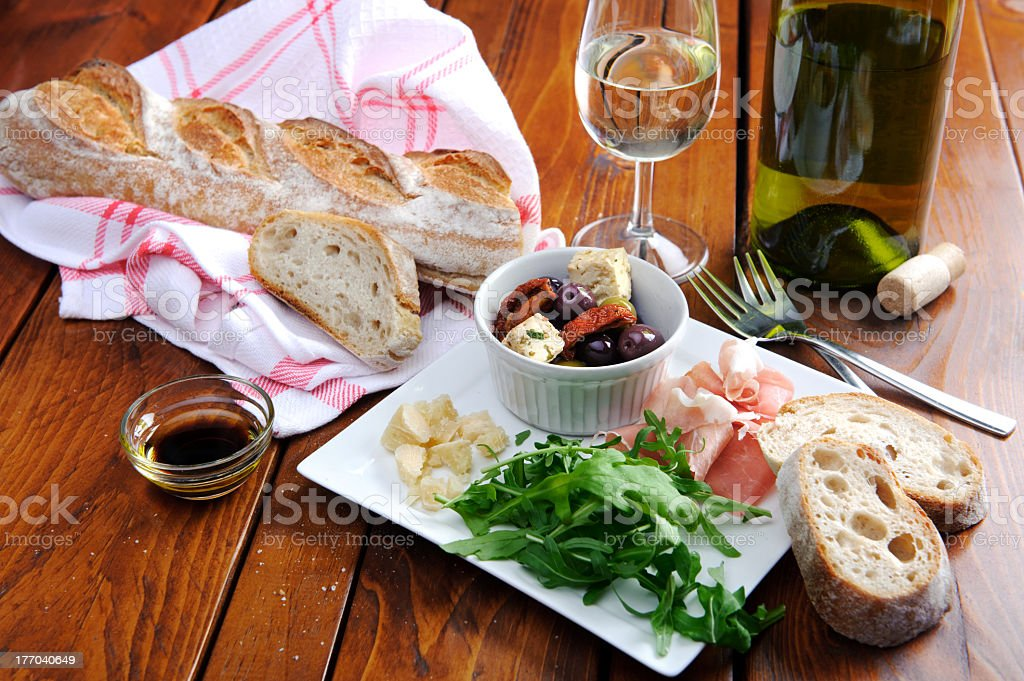 Rustic table setting with served Italian food royalty-free stock photo