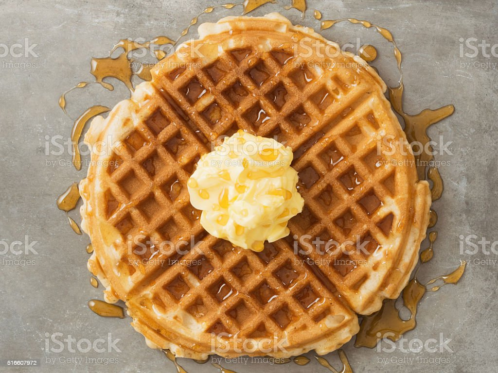 rustic traditional waffle with butter and maple syrup stock photo