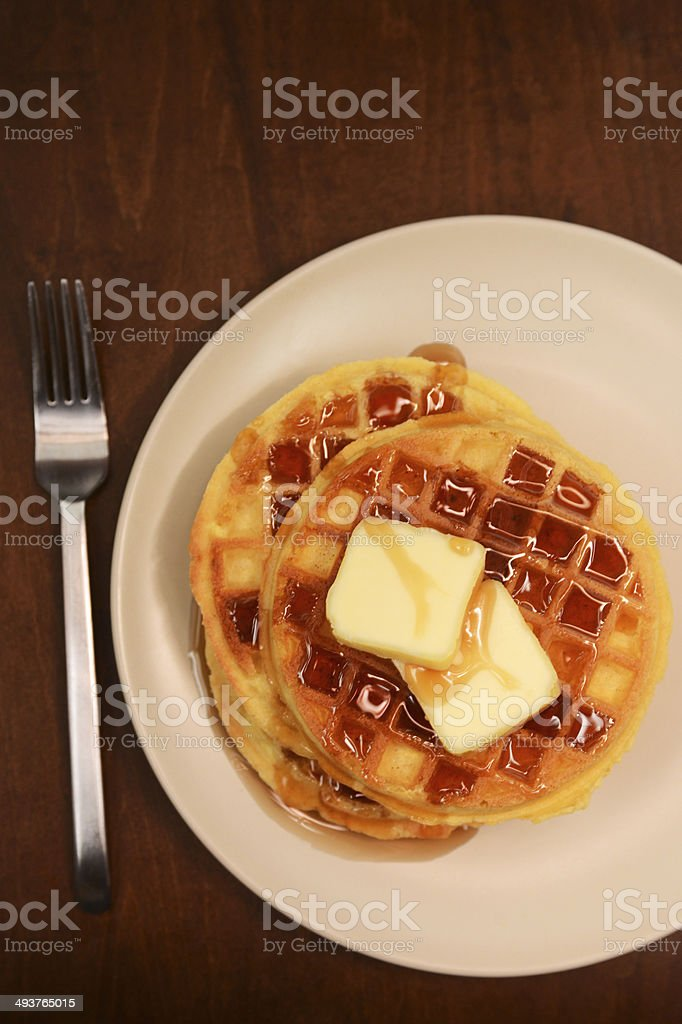 rustic waffles and syrup stock photo
