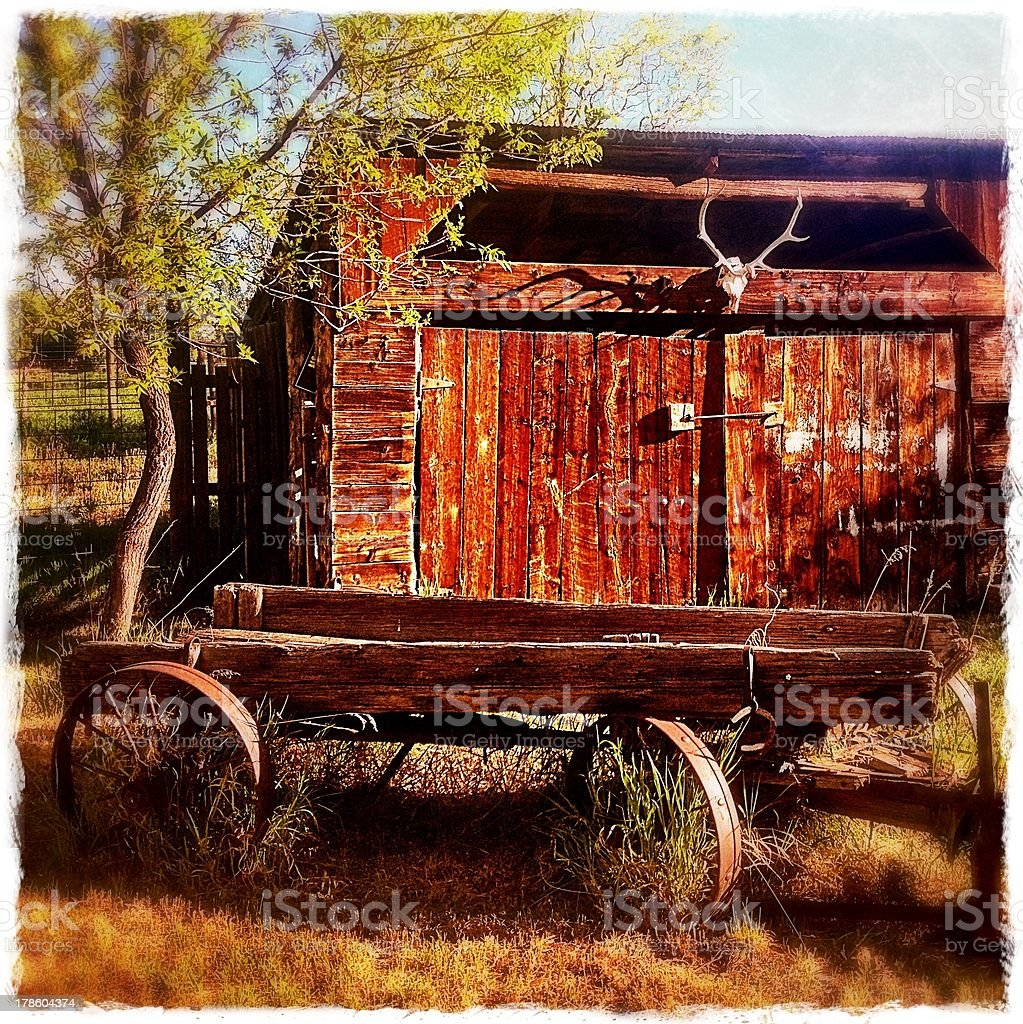 Rustic Wagon and Barn royalty-free stock photo