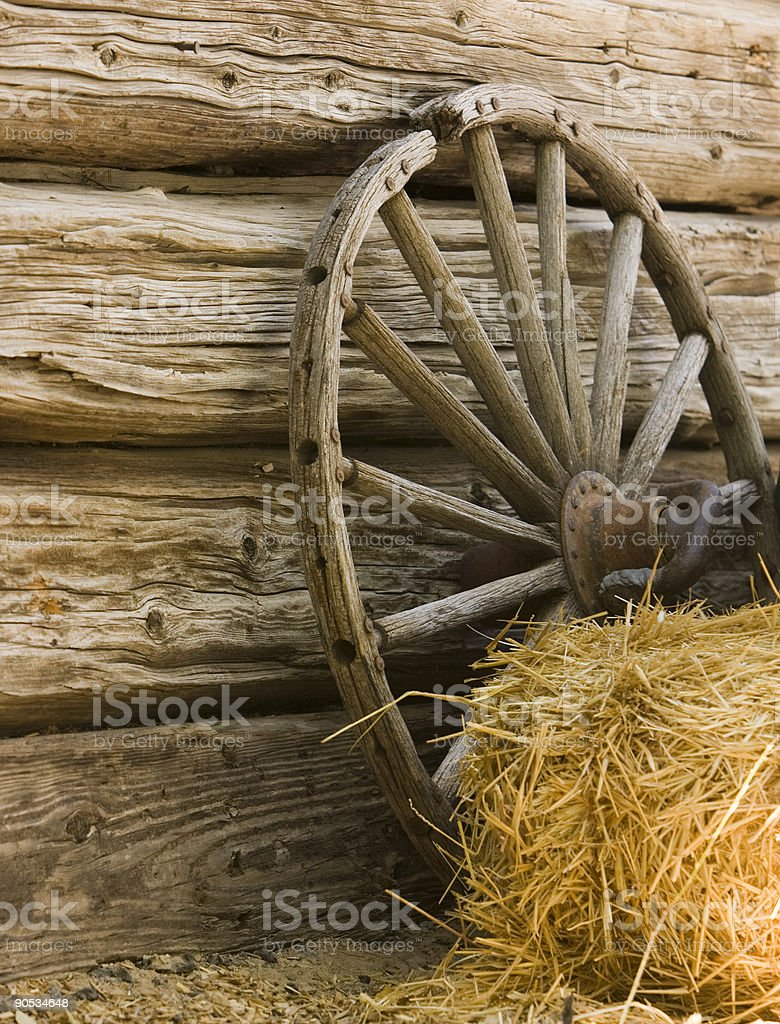 Rustic Wagon Wheel with Hay Bale stock photo