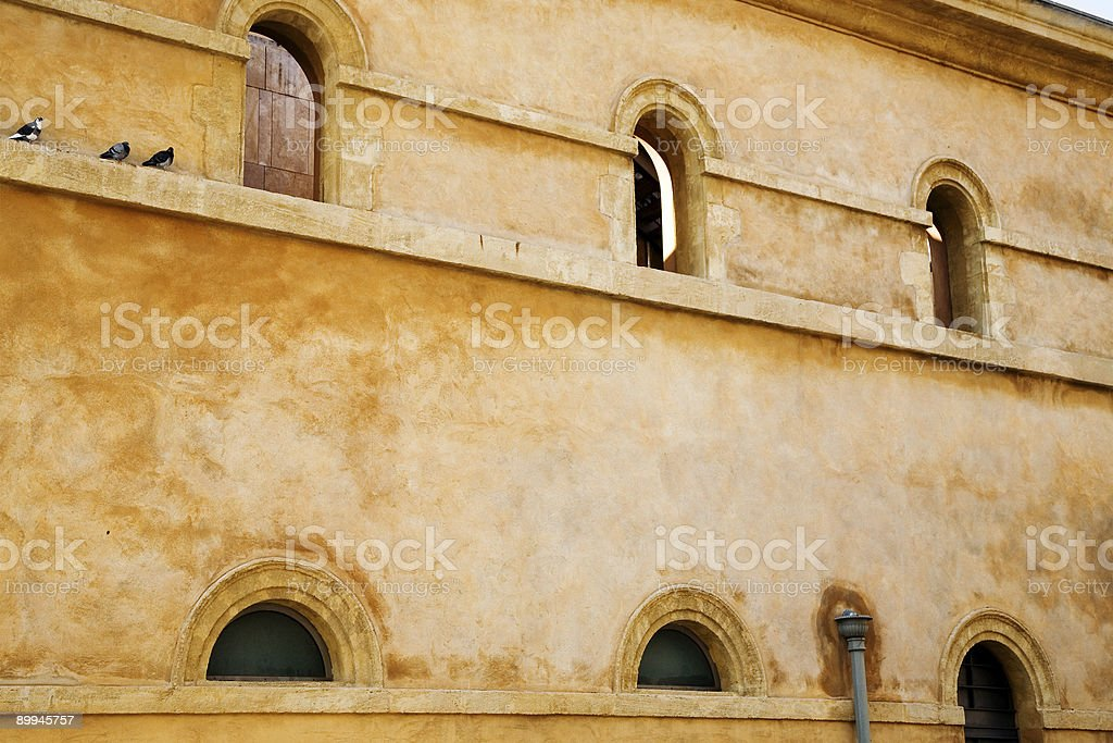 rustic wall with arched windows royalty-free stock photo