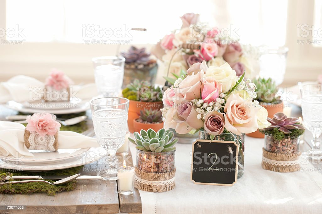 Rustic wedding wood dining table with environmentally friendly place setting stock photo