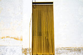 Rustic Whitewashed Walls and Yellow Beaded Curtain, Sicily