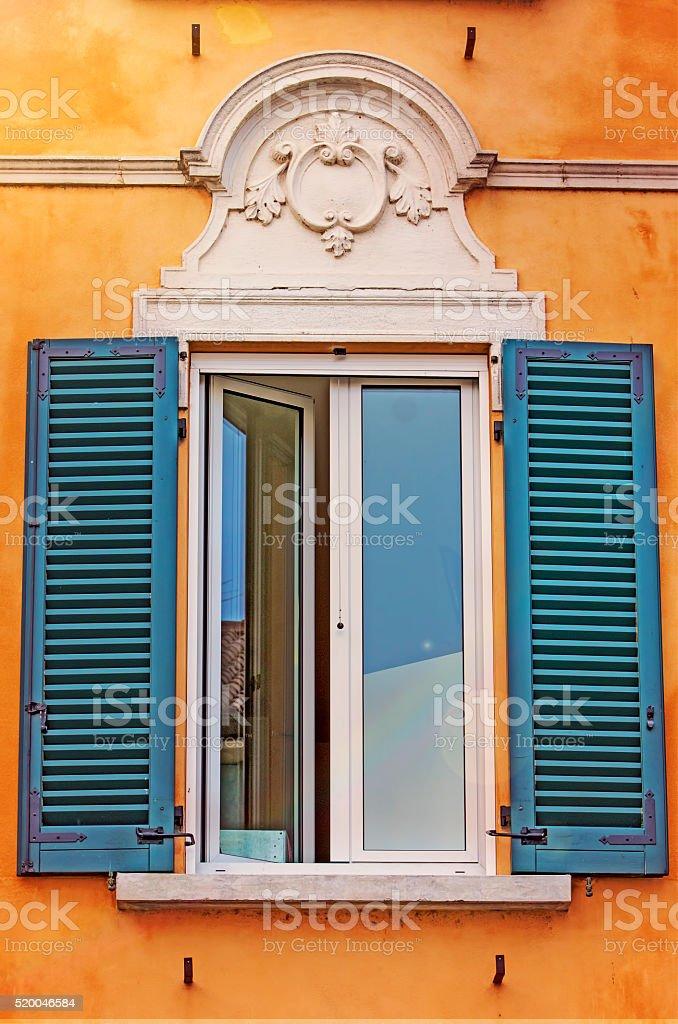 Rustic window shutters stock photo