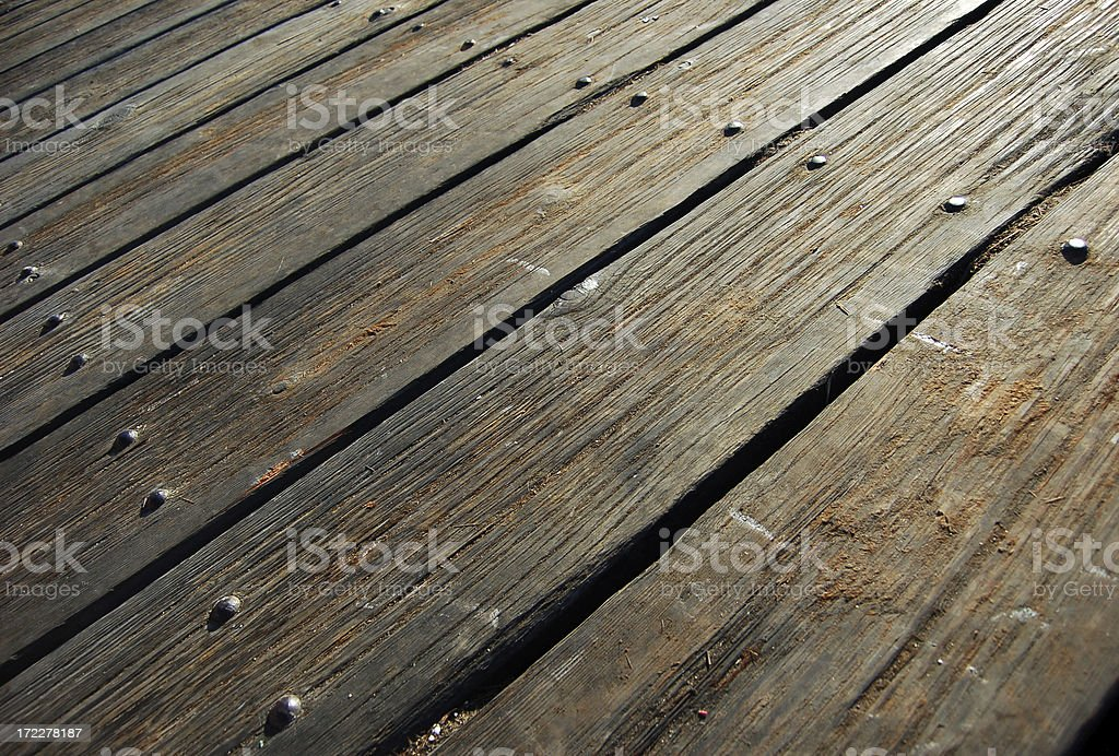 Rustic wood deck flooring with nails in line stock photo