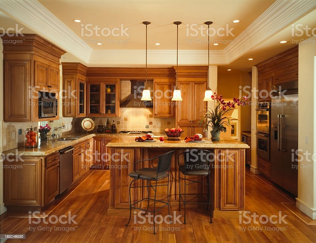 Rustic wood kitchen with silver appliances stock photo