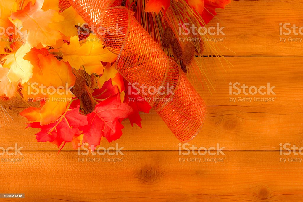 Rustic wood wall with fall leaves and ribbon background(P) stock photo