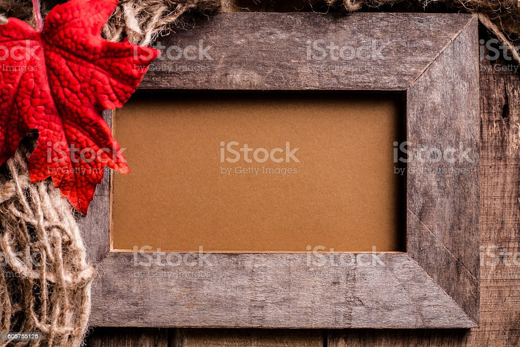 Rustic wooden art or picture frame background with fall leaf. stock photo